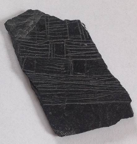 Figure 11. Slate fragment incised with a ship's riggings, planking and possible gun ports.