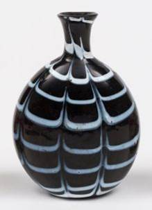 Figure 8Glass flask decorated in the same fashion as the amethyst beaker in Figure 7. (source: https://www.the-saleroom.com)